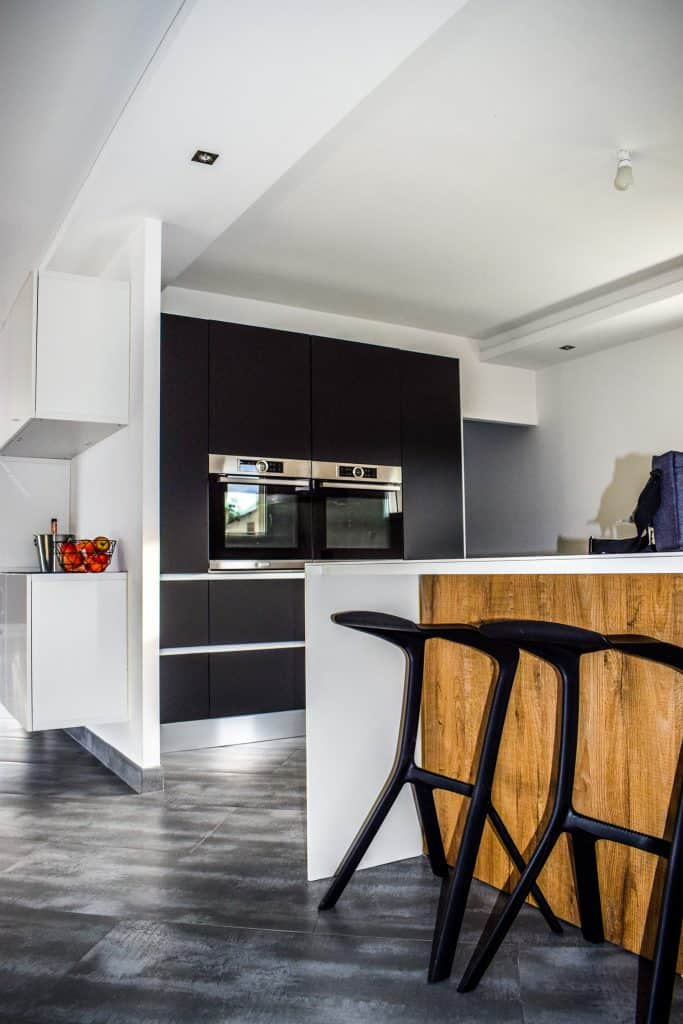 Modern Popular Interior Design Style and the Home Decor pieces to have for each of them: Slick kitchen with designer stools and steel appliances