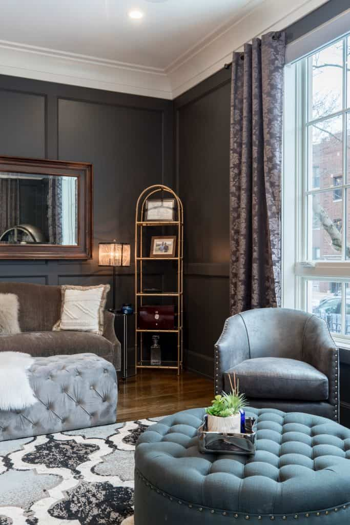 Hollywood Glam Popular Interior Design Style and the Home Decor pieces to have for each of them: Living room with tufted ottomans, thick rug and curtains, and polished metal bookshelf